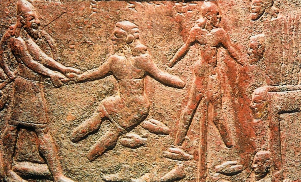 15.03.12.A. RELIEF CARVING OF ASSYRIANS IMPALING ISRAELITES