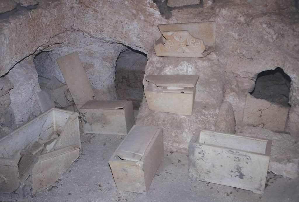 09.04.02.C. LIMESTONE OSSUARIES IN A FAMILY TOMB (2)